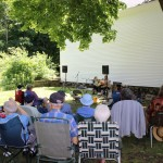 Outdoors in July at the Meeting House Stage!